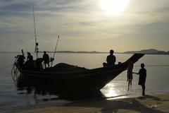 Fishermen arriving early morning at the beach, island kho samui, thailand Stock Photos