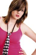 Stock Photo of young woman wearing pink t-shirt and tie
