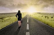 Stock Photo of businesswoman standing on the highway road