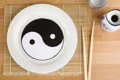 ying and yang on a plate - stock photo