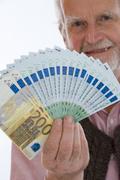 Stock Photo of retiree with money