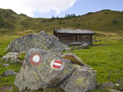 Stock Photo of mountain lodge and trail markings, karlalm alpine pasture (uncultivated), gro