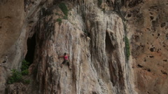 climber climbing a cliff with insurance - stock footage