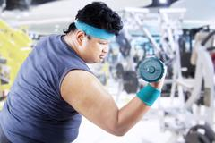 overweight man doing fitness - stock photo