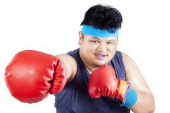 overweight man exercise by boxing - stock photo