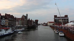 Motlawa river in Gdansk, Poland. Old town at evening during St. Dominic market Stock Footage
