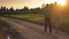 Brother and sister walking down the road and relaxing in nature, love, peaceful Stock Footage
