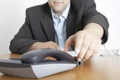 Man answers the telephone Stock Photos