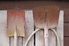 Stock Photo of red painted shovels used as fire arms at an old house at prerow darss germany