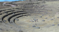 Peru Moray agricultural terraces with tourists in center s Stock Footage