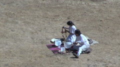 Peru Moray ritual pouring liquid s Stock Footage
