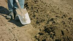 Digging of arable land with a shovel - the old way Stock Footage