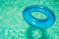 Inner tube in swimming pool. Stock Photos