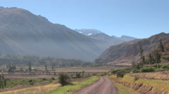 Peru Sacred Valley dirt road toward Andean peak 10 Stock Footage
