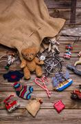 Presents and gifts of santa's sac: old wooden antique toys for children. Stock Photos