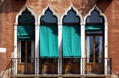 Venezian house front with windows, venice, italy Stock Photos