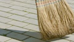 Sweeping the sidewalk. broom close up Stock Footage