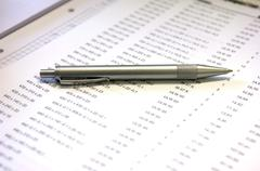 A ballpen lying on a list of numbers Stock Photos