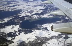 Aerial view (out of aeroplane, with wing) of woerthsee and environs in winter Stock Photos