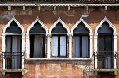 venezian house front with windows, venice, italy - stock photo