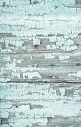 old wooden background with peeled colour and cracks in mint green color. - stock photo