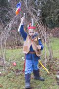Dressed up boy plays playing indian native american Kuvituskuvat