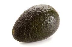 one avocado on bright background - stock photo