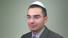 4K Jewish Businessman With Kipah Looking At Camera Stock Footage