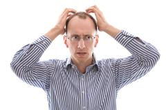sad and shocked bald isolated man in blue shirt. - stock photo