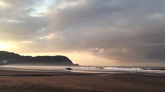 Stock Video Footage of Surfer in the morning at Jaco beach in Costa Rica