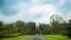 Time lapse 4k. Balinese gate behind which the mountains and swirling clouds Stock Footage