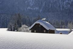a old wooden house and a lot of snow krungl styria austria - stock photo