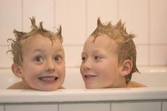 Two little boys 5 and 7 year old in the bath tub Stock Photos