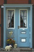 Stock Photo of colored entrance door at a typical house at wustrow fischland germany
