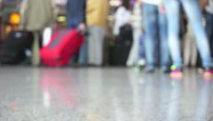 Passengers walking at airport out of focus - stock footage