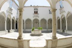 cloister of the franciscan monastery at piran at the adriatic coast - sloveni - stock photo