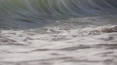 Sea waves crashes on the beache in close-up Stock Footage