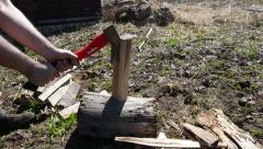 Man chopping wood with an ax Stock Footage