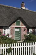Entrance of a typical old house in soenderho at fanoe island, denmark Stock Photos