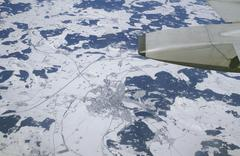 Aerial view (out of aeroplane, with wing) of the town leutkirch and environs  Stock Photos