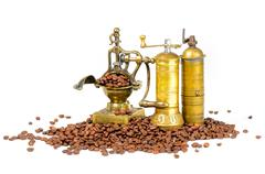 Coffee Grinders With Beans on White Stock Photos