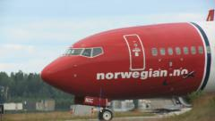 Airplane taxiing at Oslo Airport Norwegian B738 right to left Stock Footage