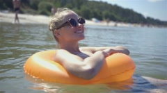 Happy girl with lifebuoy enjoying water - stock footage