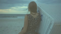 Silhouette of young woman looking at the sea, rear view Stock Footage