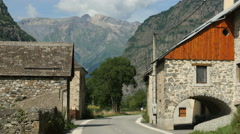 Scenic village in French Alps set against mountains Stock Footage