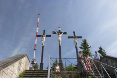Antenna broadcast signal aerial mast and crucifix on kreuzberg - franconia -  Stock Photos
