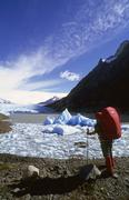 woman hiking at the lake of glaciar grey torres del paine national park chile - stock photo