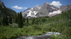 Maroon Bells and River, Colorado, Rocky Mountains USA Stock Footage