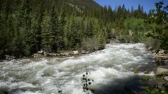 Water running in flowing stream / river - stock footage