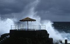 Heavy surging billows floating over a public bath near san andres at la palma Stock Photos